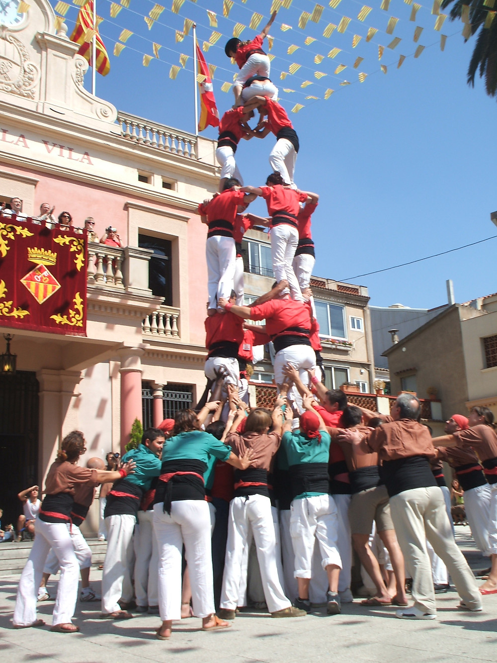 Castellers in action making a human tower at Festa Major de Gracia