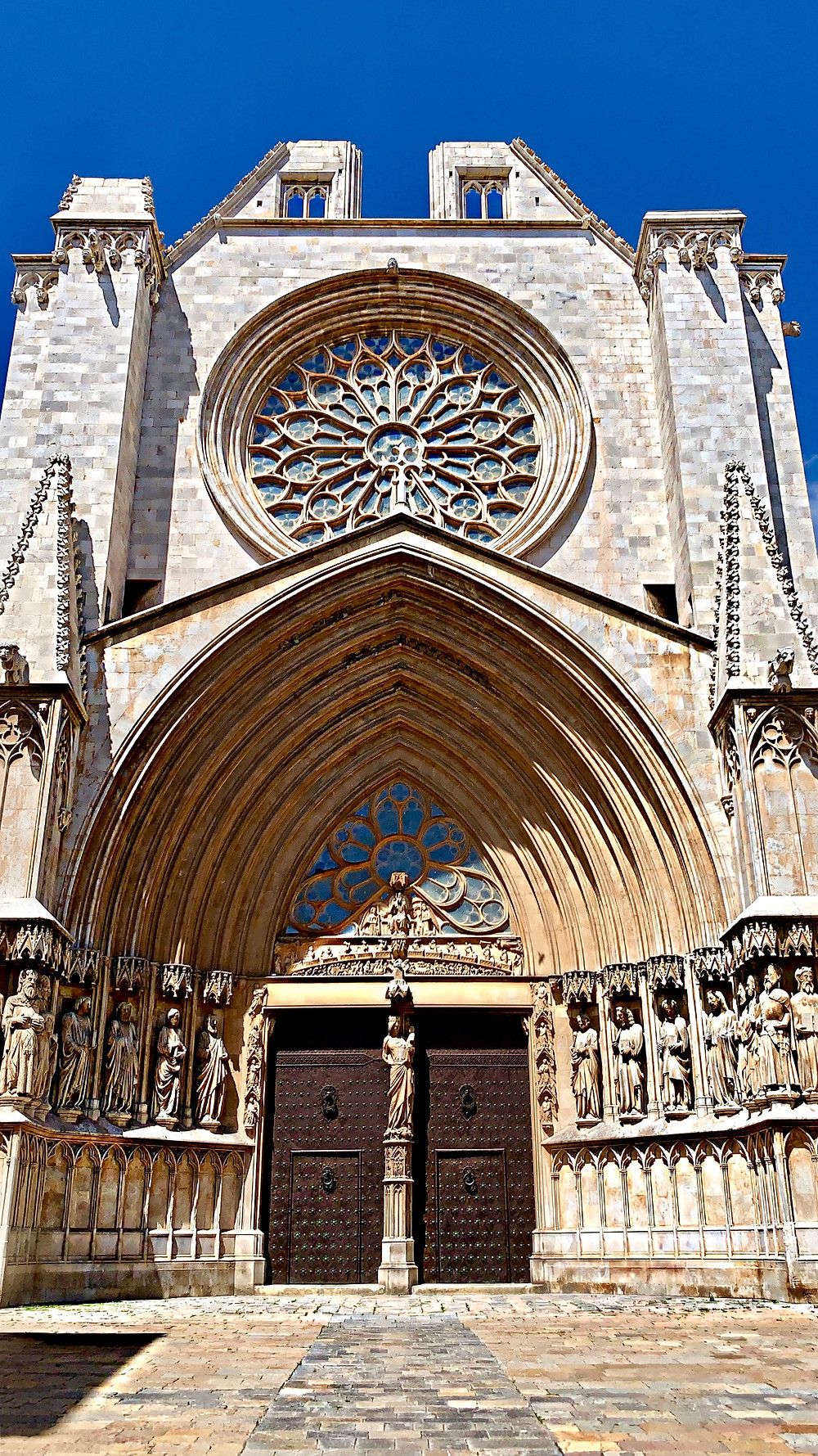 Upwards look at the front facade of the Cathedral of Tarragona in Spain