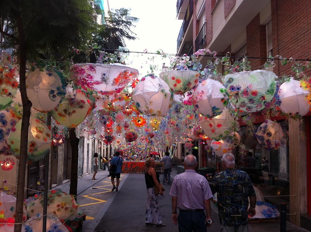 Decorate street with lanterns at Festa Major de Gracia