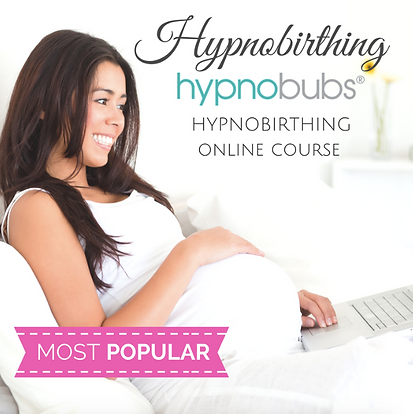 Pregnant woman smiling, looking at her laptop