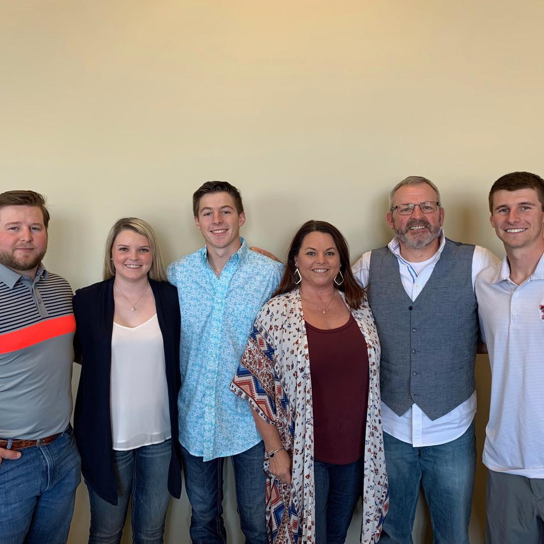 Lora's family: Brandon (wife Heather), Brett, and Brian.