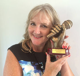 Alison Cowell with radio award.jpg