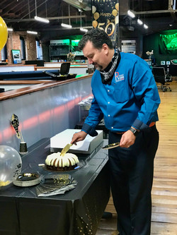 Slicing the carrot cake