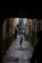 Dark alley Essaouira boy