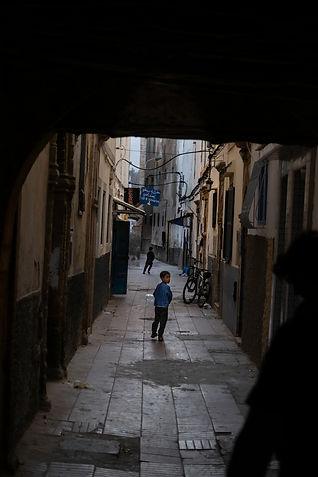 Dark alley Essaouira boy