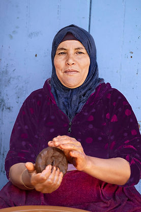 Woman Essaouira making argaine oil
