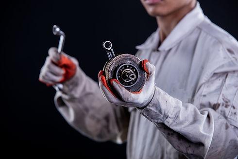 car-mechanic-wearing-white-uniform-stand
