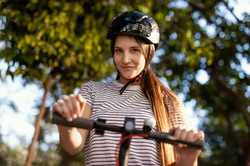 young-woman-rides-electrical-scooter-par
