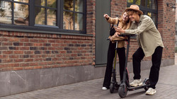 couple-with-electric-scooters-outdoors (