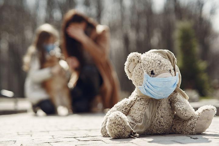 mother-with-daughter-walks-outside-masks.jpg