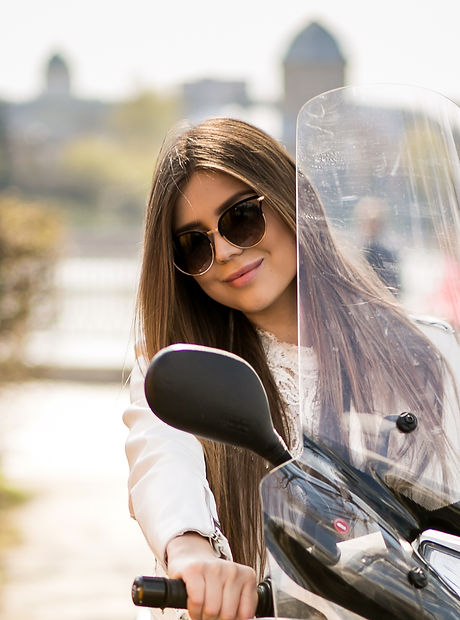 young-riding-scooter-female-woman.jpg