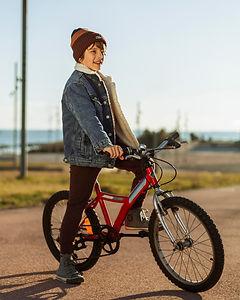 boy-riding-his-bike-outdoors-city.jpg
