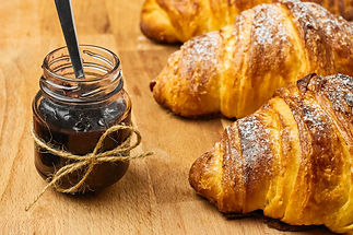 freshly-baked-croissant-with-berry-jam-j