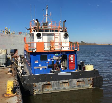 Lugger-style Tug docked.png