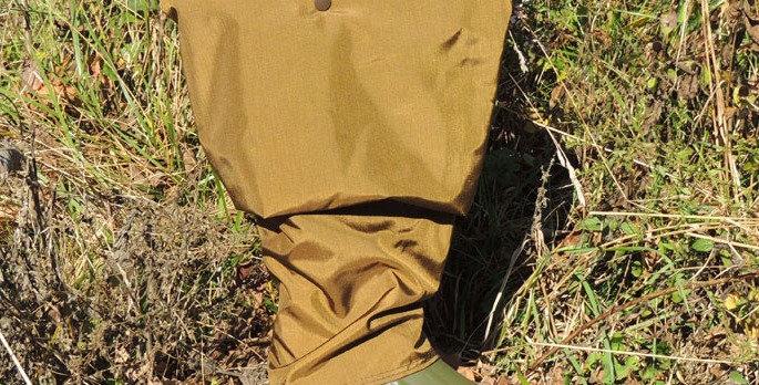 Brown waterproof briar proof frog leg wader on green lacrosse grange boot.  Adjustable strap on wader