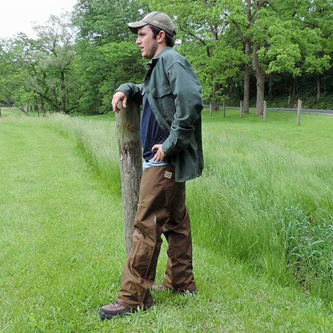 A man wearing briar proof and waterproof hunting chaps