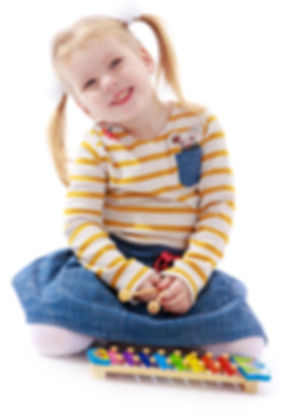 happy little girl with pigtails sitting
