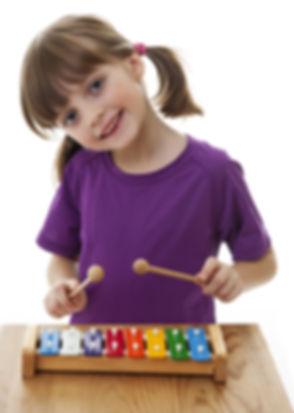 little girl playing xylophone - isolated