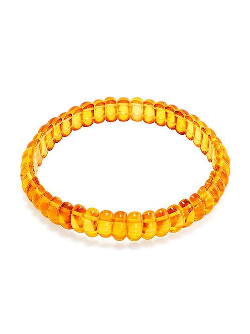Яркий браслет из цельного балтийского янтаря золотистого цвета