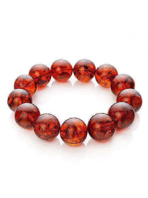Объёмный браслет из натурального янтаря вишнёвого цвета «Юпитер»