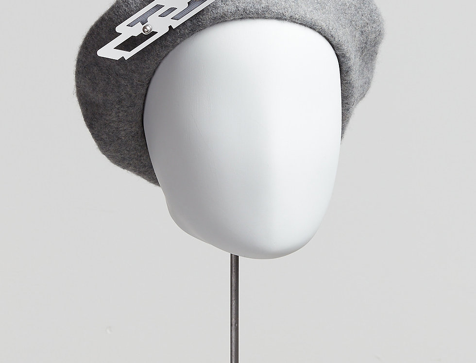 pale grey marl 100% wool beret with laser-cut acrylic brooch with Swarovski pearls - front view