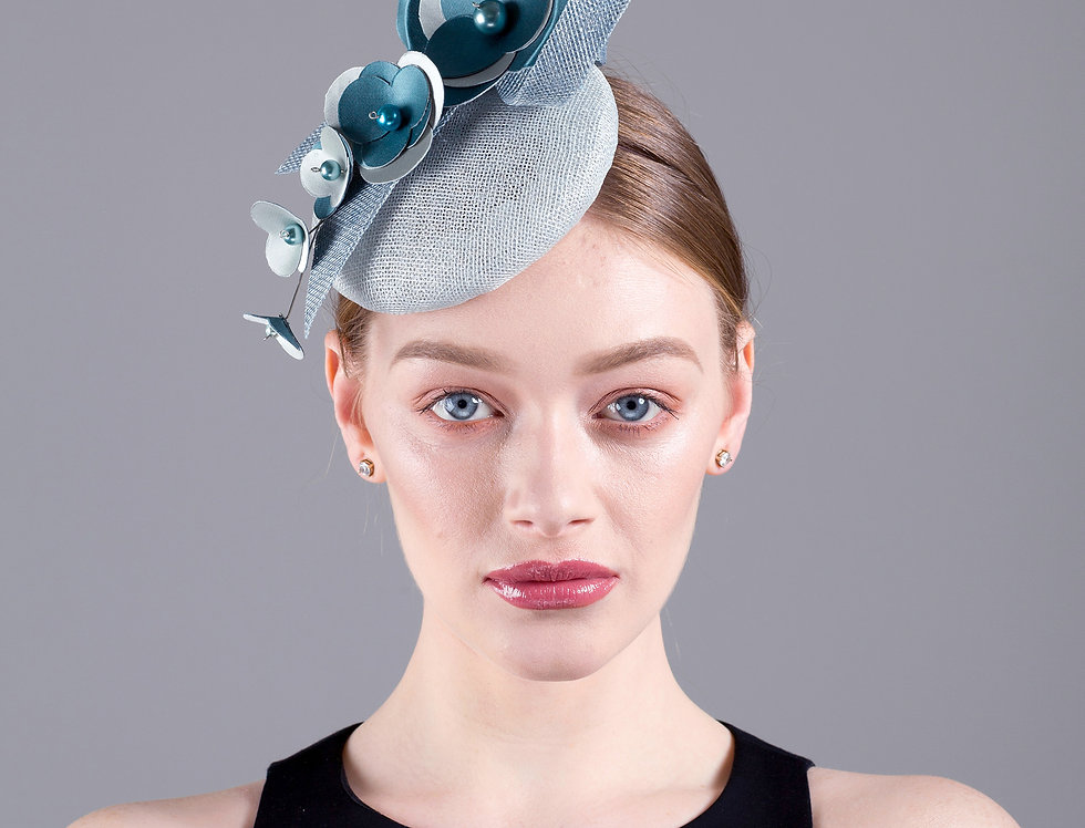 Jolie small pillbox hat with spray of origami flowers and sinamay loops