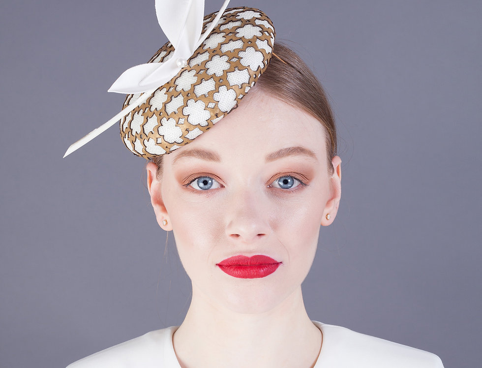 Chie pillbox hat with geometric leather overlay and origami leaf trim