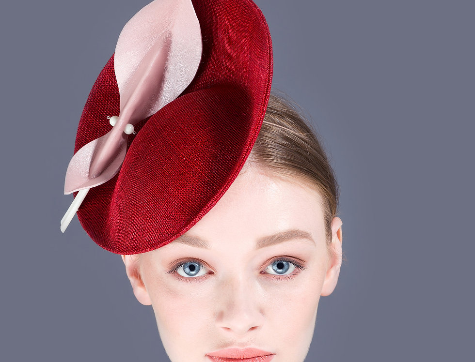 Mari small tilted saucer hat with origami leaf shaped trim and quill