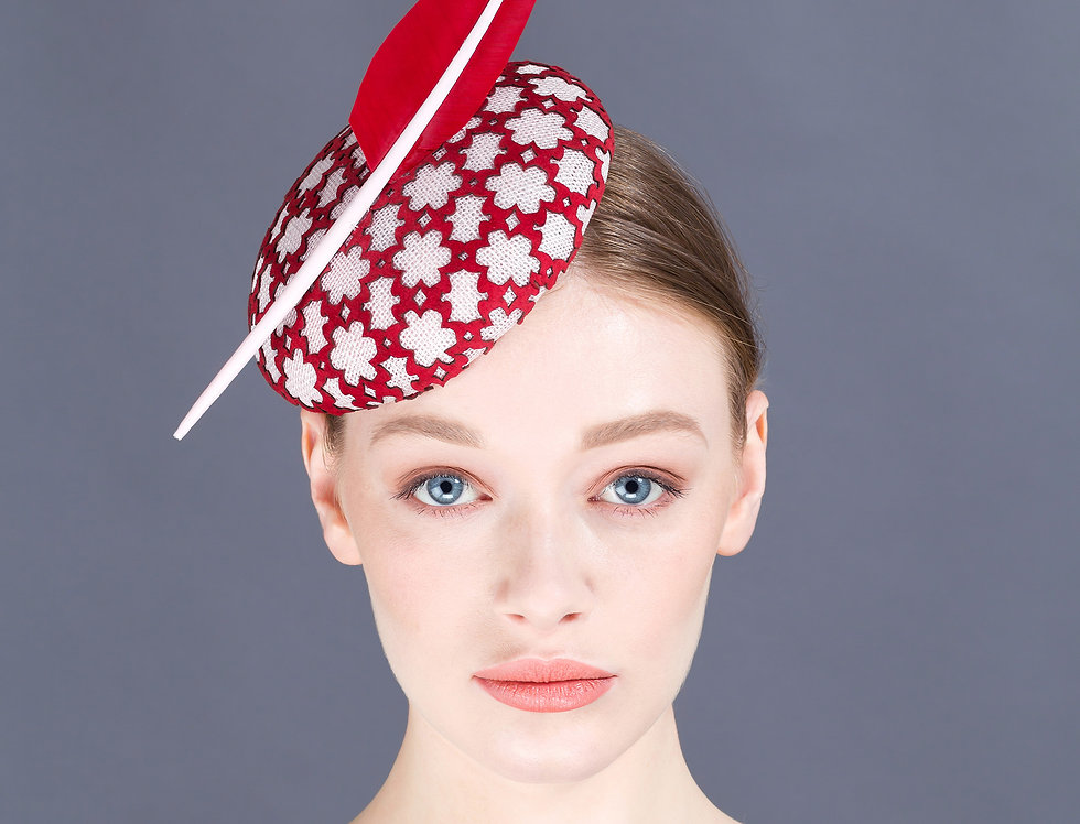 Chieko small pillbox hat with geometric leather lace overlay and statement feather