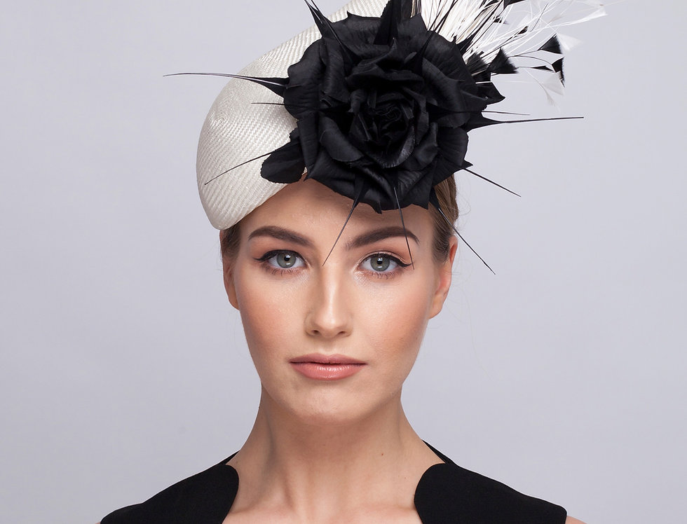 Carmen teardrop shaped pillbox perching hat with large feather spray and roses