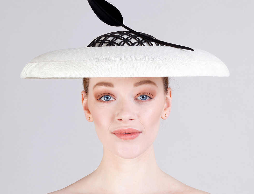 Amaya boater hat with curled brim and leather overlay on crown and statement feather