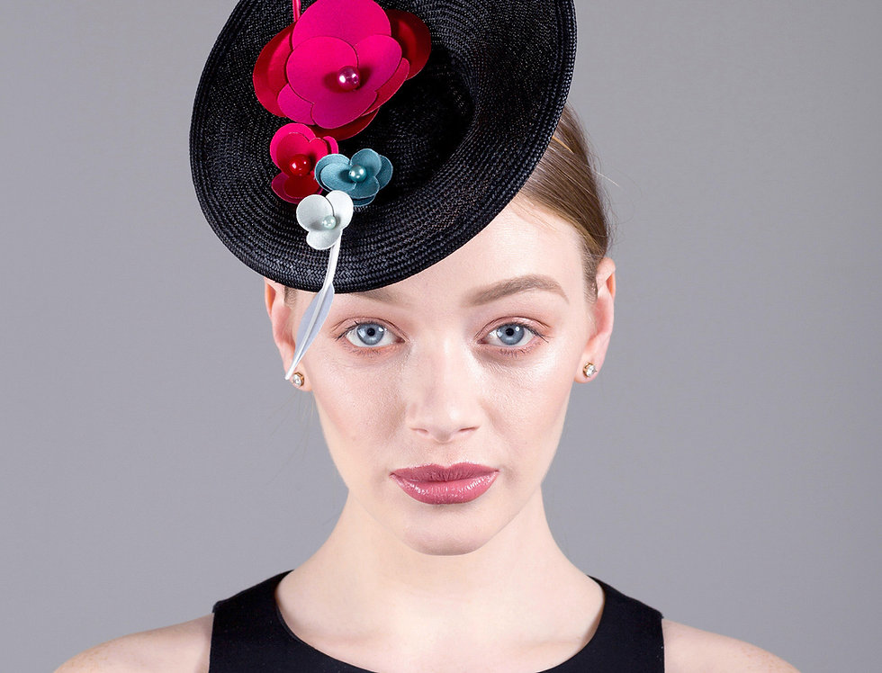 Deja tilted saucer hat with small spray of origami flowers and 2 feathers