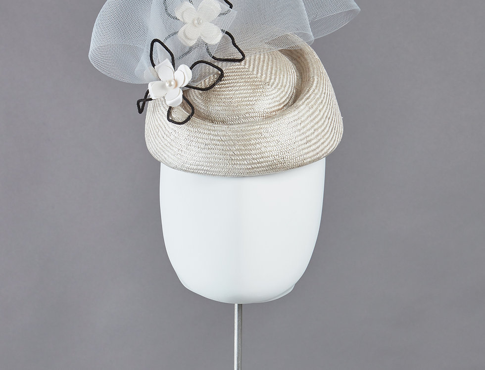 Sally-Ann Provan -  oval pillbox hat with pork pie centre and three origami flowers - front view