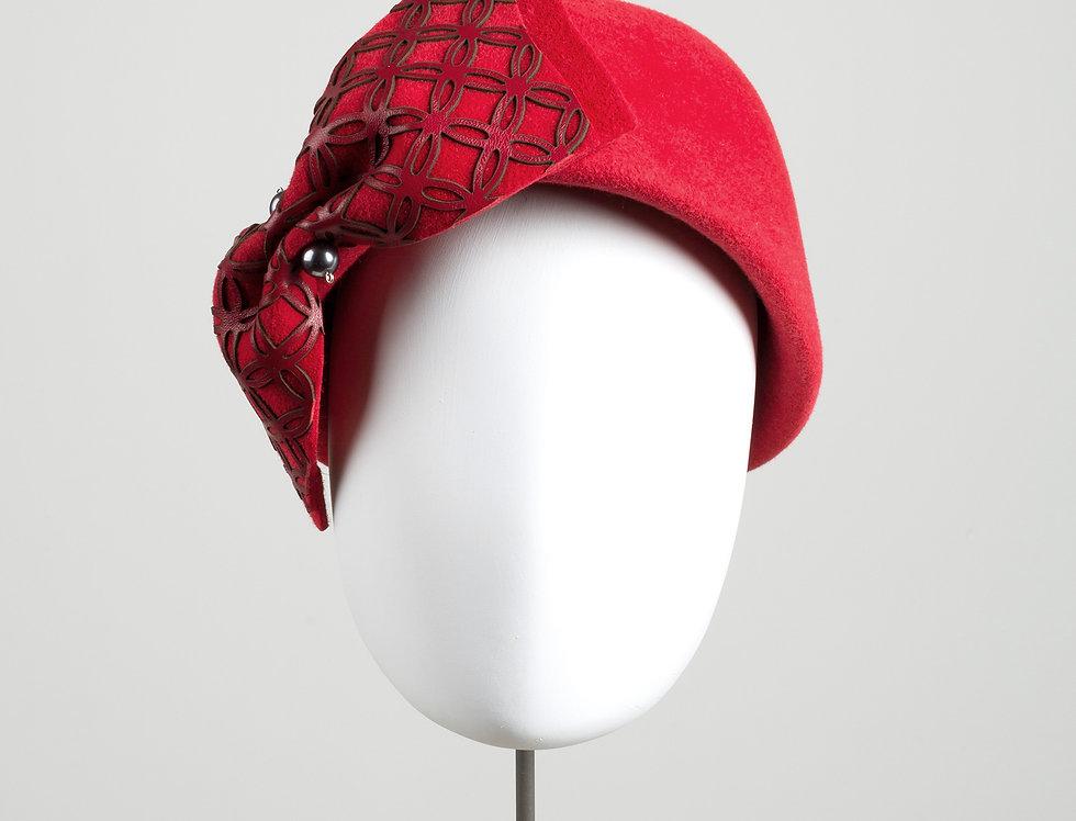 Panji felt pillbox hat with large bow with geometric pattern