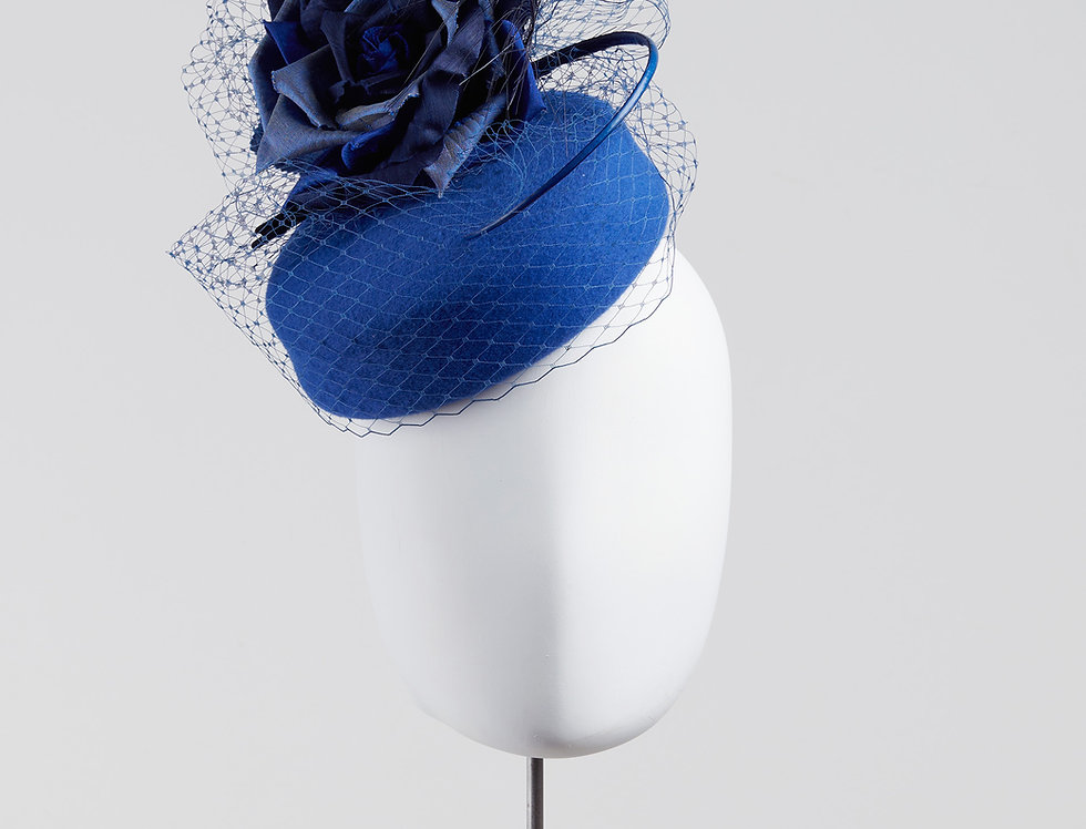 Rasen felt pillbox hat with silk flower and veiling - front view