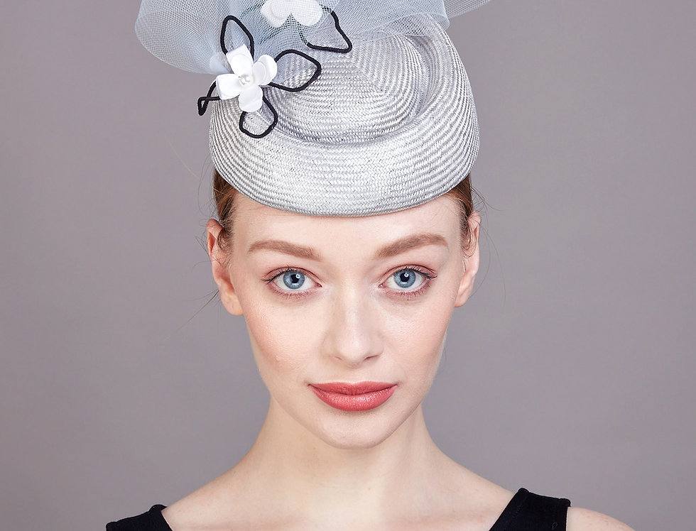 Alvia oval pillbox hat with pork pie centre and three origami flowers - front view