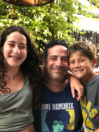 A family photo of Judge Dan Sulman and his daughter and son.