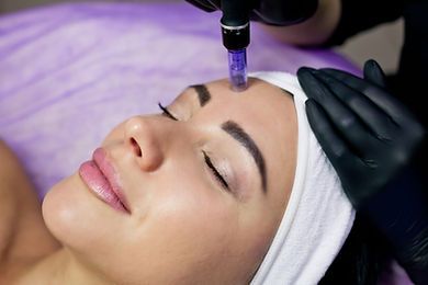 Beautician makes mesotherapy injections. Microneedle mesotherapy. Treatment of a woman by
