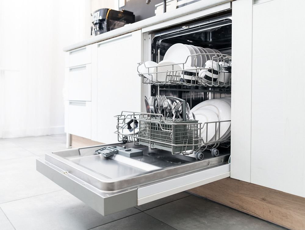 open dishwasher with dishes inside