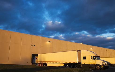 Semi Truck in the loading zone of the wa
