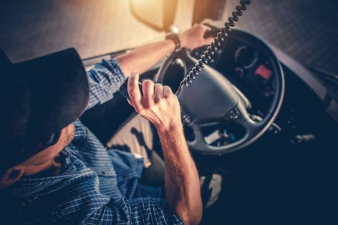 Semi Truck Driver Making Conversation wi