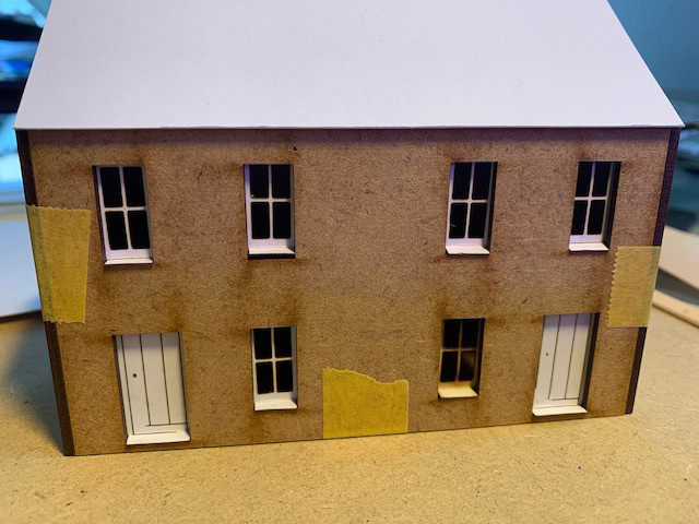 Laser-cut 2mm MDF cottages with laser-cut card doors and windows - unpainted.