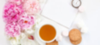 Tea time. Flat lay over light background with peonies and cup of tea.jpg