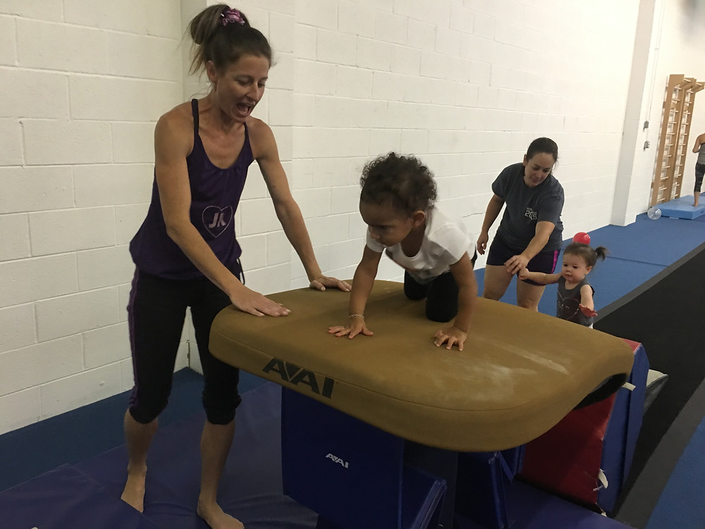 Owner/Coach Judy Kennedy leads Busy Bees class on Saturday. 1-3 year olds are assisted by their parents while they navigate obstacles and learn fundamental motor patterns and skills.