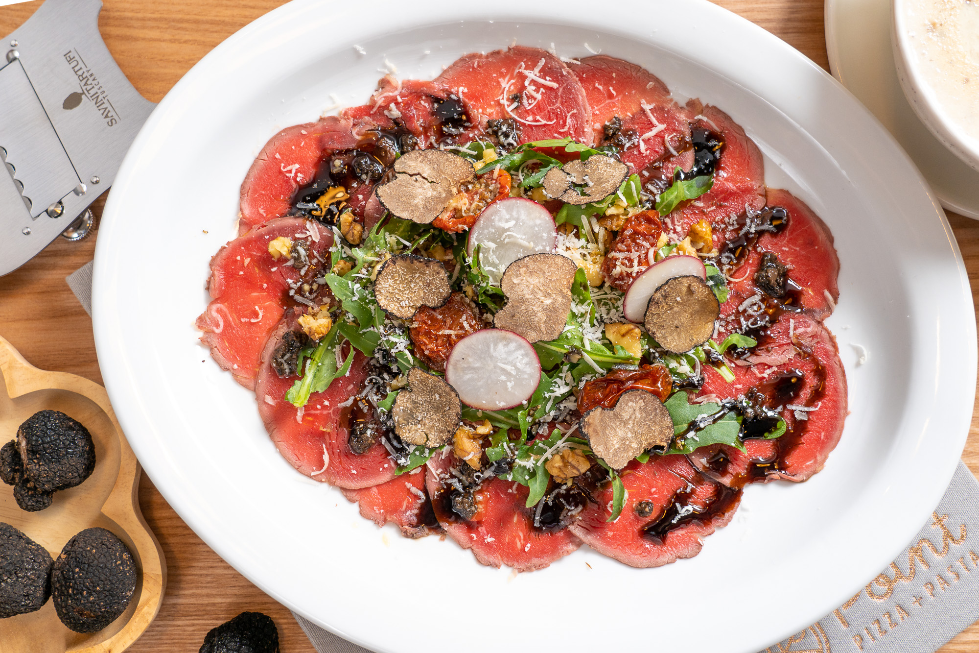 Beef Carpaccio with Black Truffle and Arugula Salad