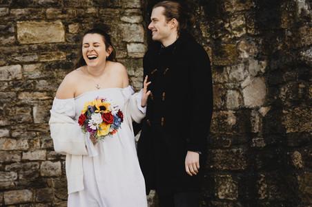 Wedding photo of couple laughing.jpg