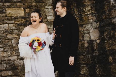 Wedding photo of couple laughing.jpg