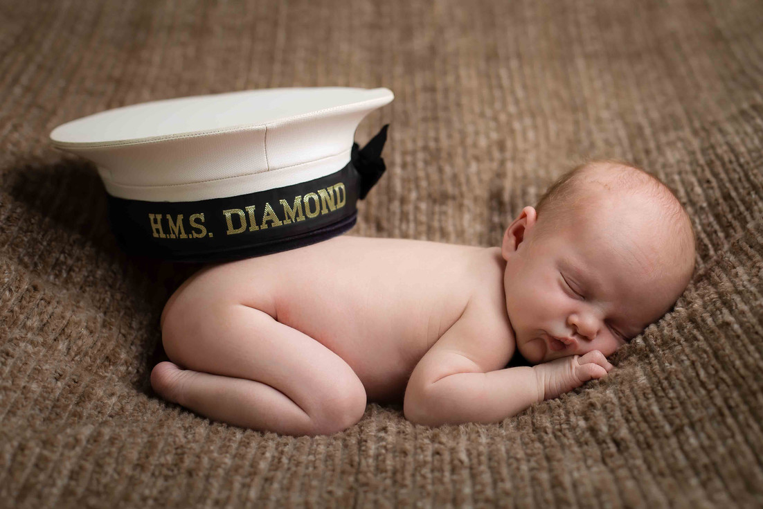 Newborn hotography props with hat.jpg
