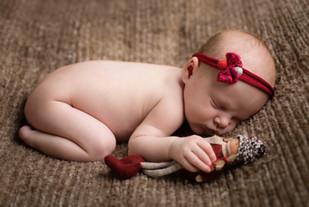 Baby photoshoot wearing red headband.jpg