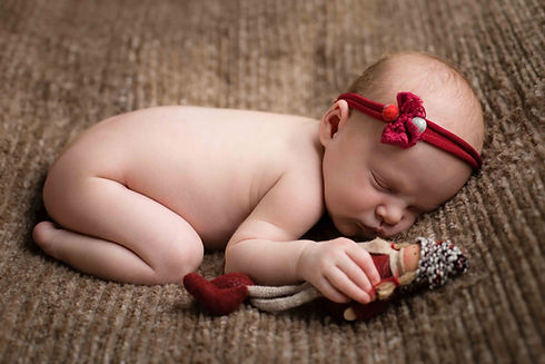 Baby photoshoot wearing red headband.jpg